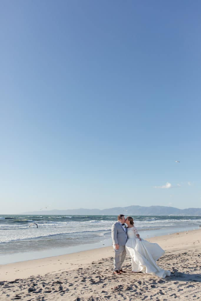 Romantic beach photos of Bride and Groom after ceremony in Santa Monica