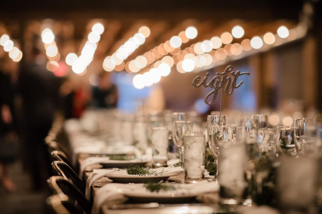 Glitter wooden table numbers on long wooden farm tables