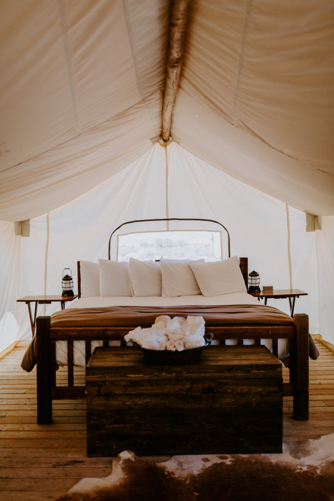 The bed inside under canvas moab glamping tent