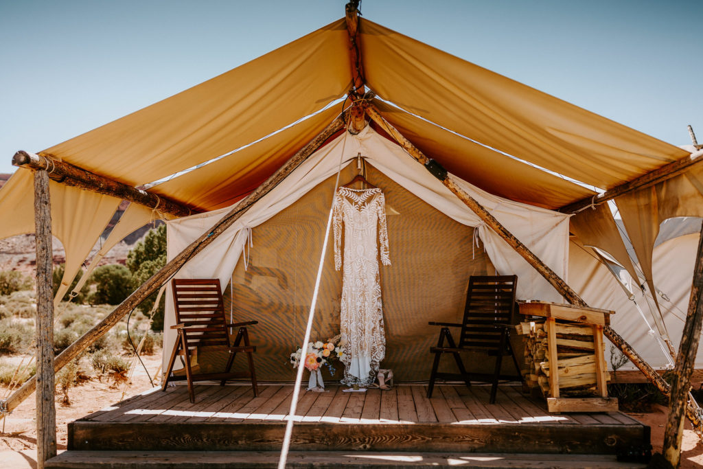 Rue de Seine gown hanging from glamping tent at Moab Under Canvas