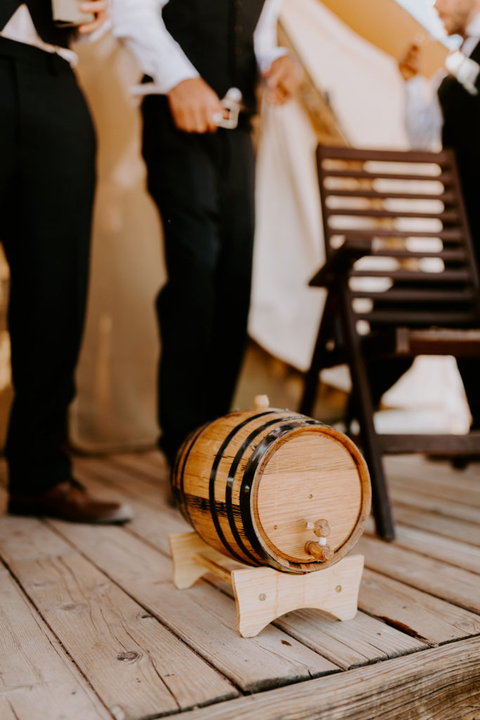Mini whiskey barrel for the groomsmen at desert wedding Moab Under Canvas