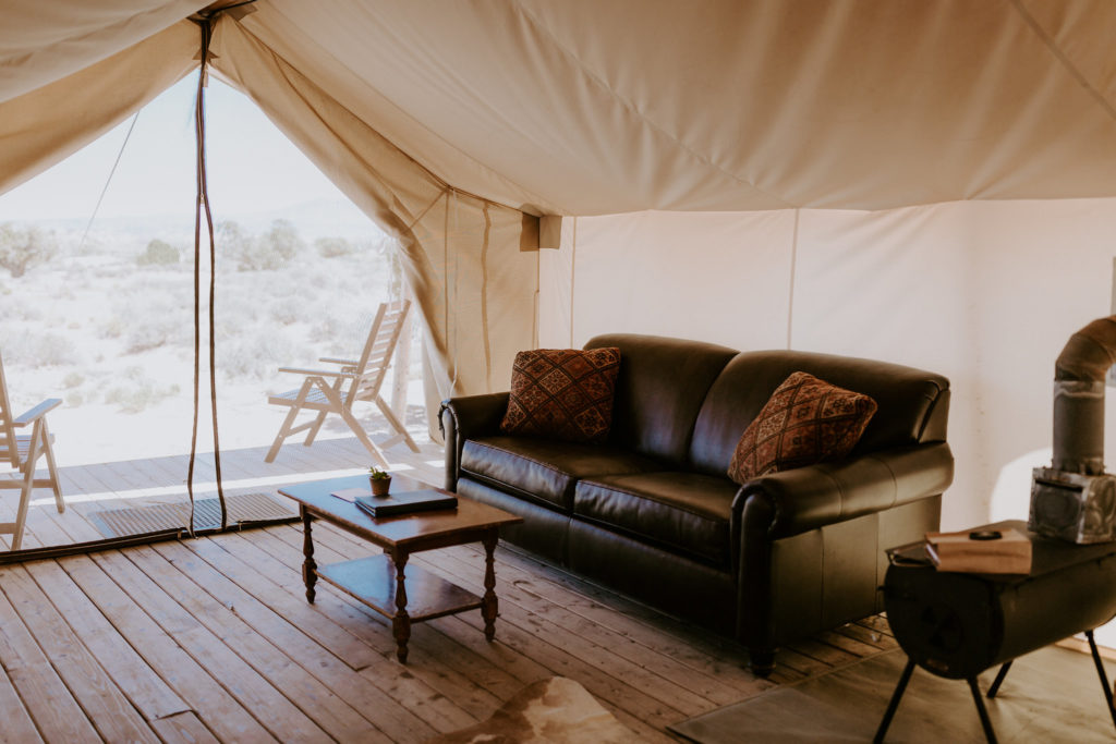 leather couch inside under canvas moab glamping tent