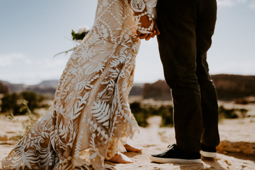 Bride and groom feet in the desert