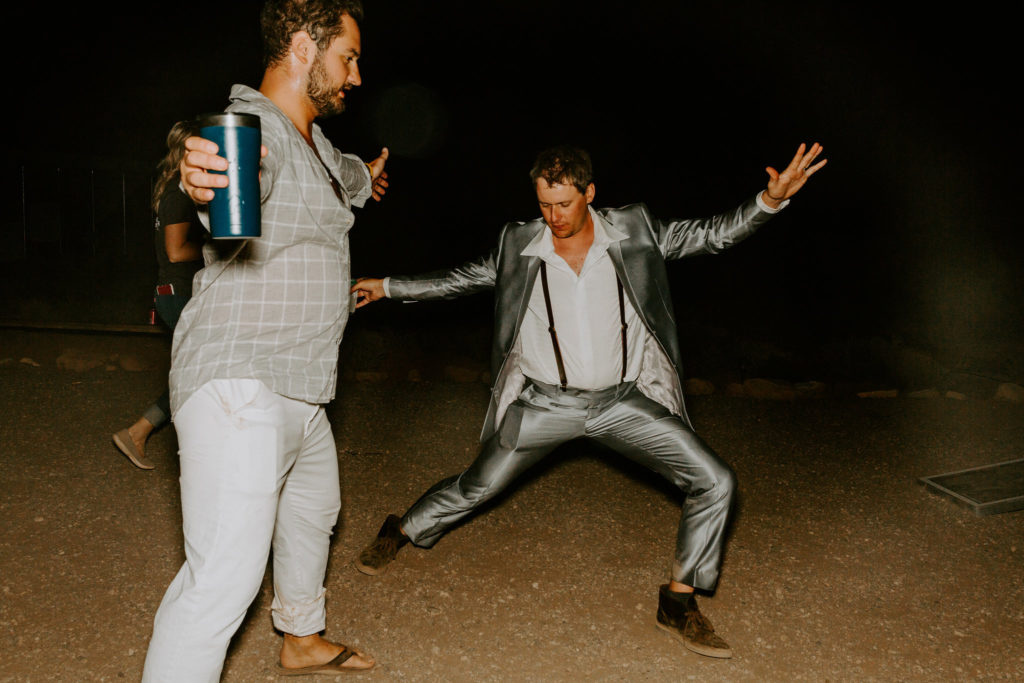 Guests dancing at wedding in the desert