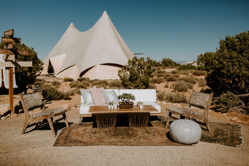 Lounge outside giant teepee at Moab Under Canvas for wedding in the desert