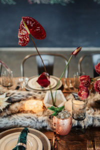 Thanksgiving table decor with faux fur table runner, geometric candle holders and velvet napkins