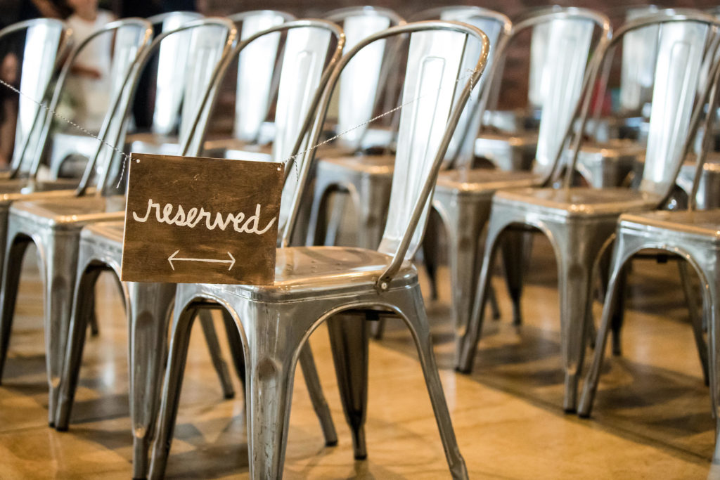 Reserved seating for wedding ceremony at The Colony House.