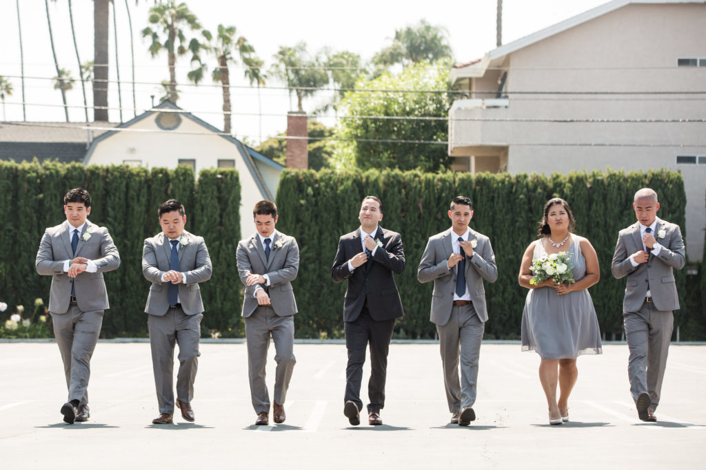 Groom and groomsmen in navy and grey attire for modern wedding at The Colony House.