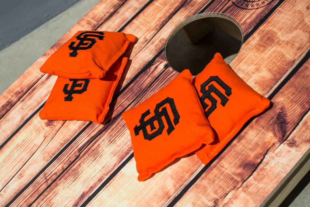 Cornhole with SF Giants bean bags for wedding games.