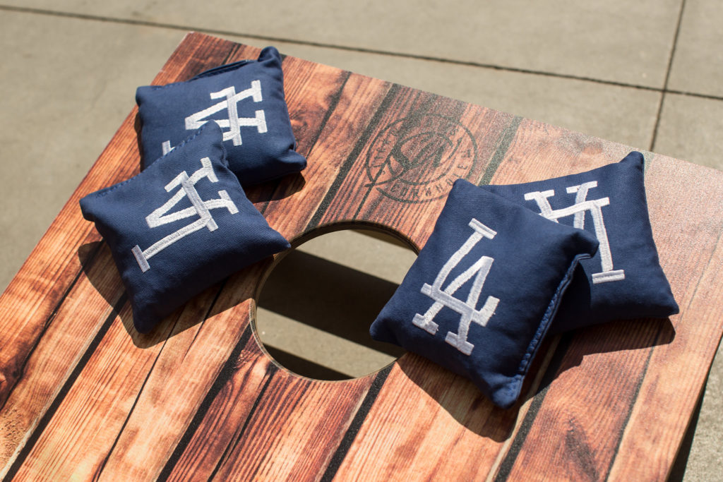 Cornhole with LA Dodgers bean bags for wedding games.