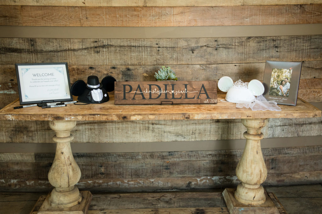 Rustic wooden welcome table for modern wedding at The Colony House.