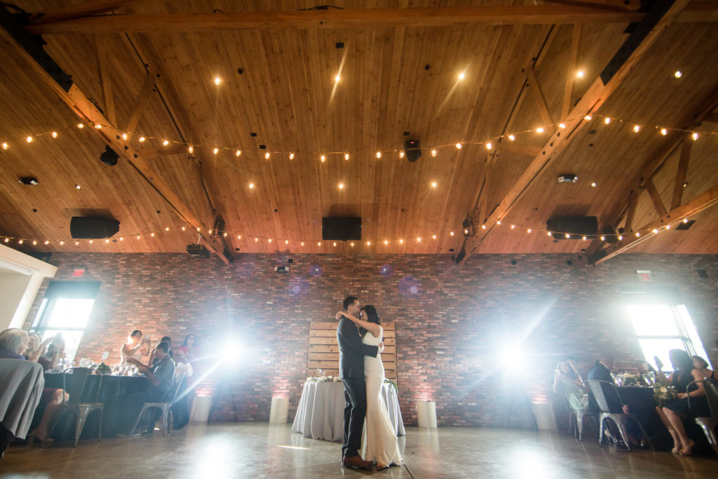 Bride and groom's romantic first dance under twinkling lights at The Colony House in Anaheim.