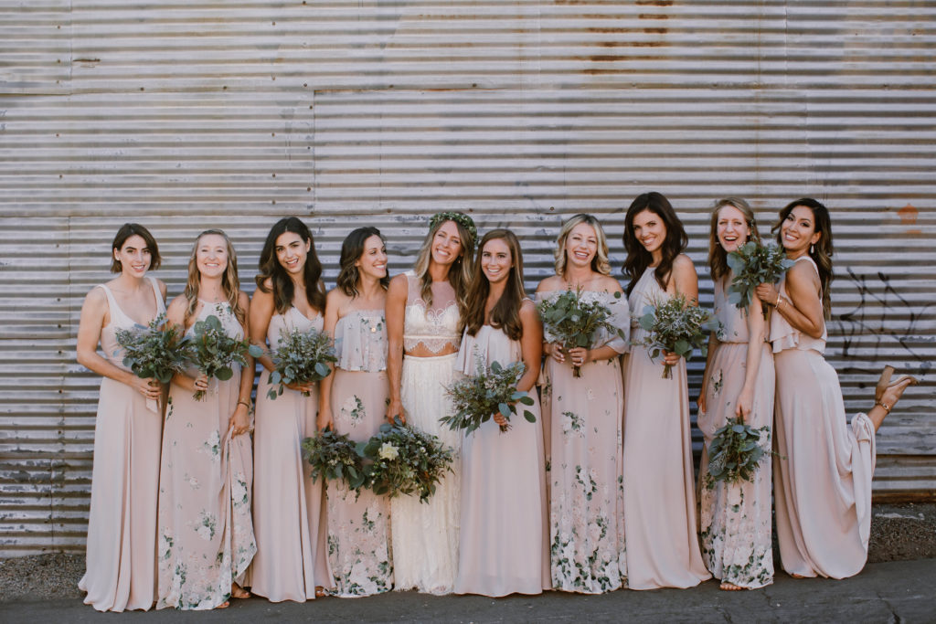 Bohemian bride and bridesmaids in white and pink dresses at Smoky Hollow Studios