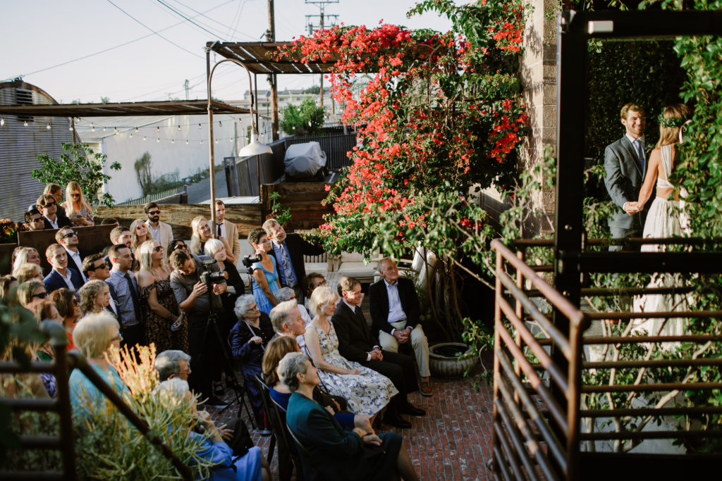 Outdoor wedding ceremony on patio of Smoky Hollow Studios