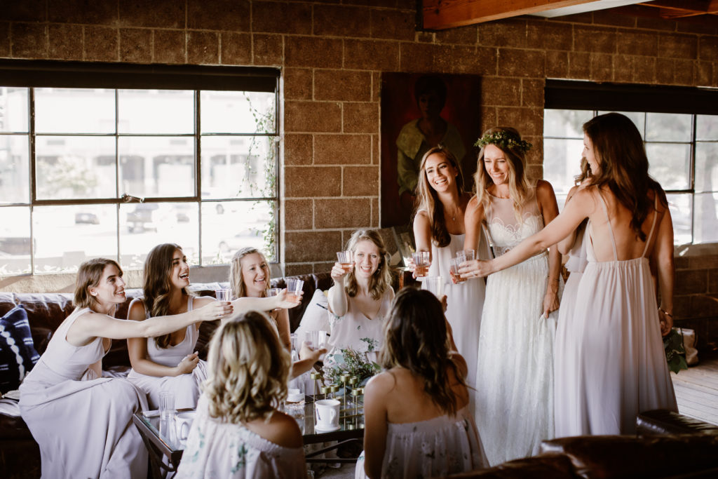 Bride and bridesmaids toast before wedding ceremony