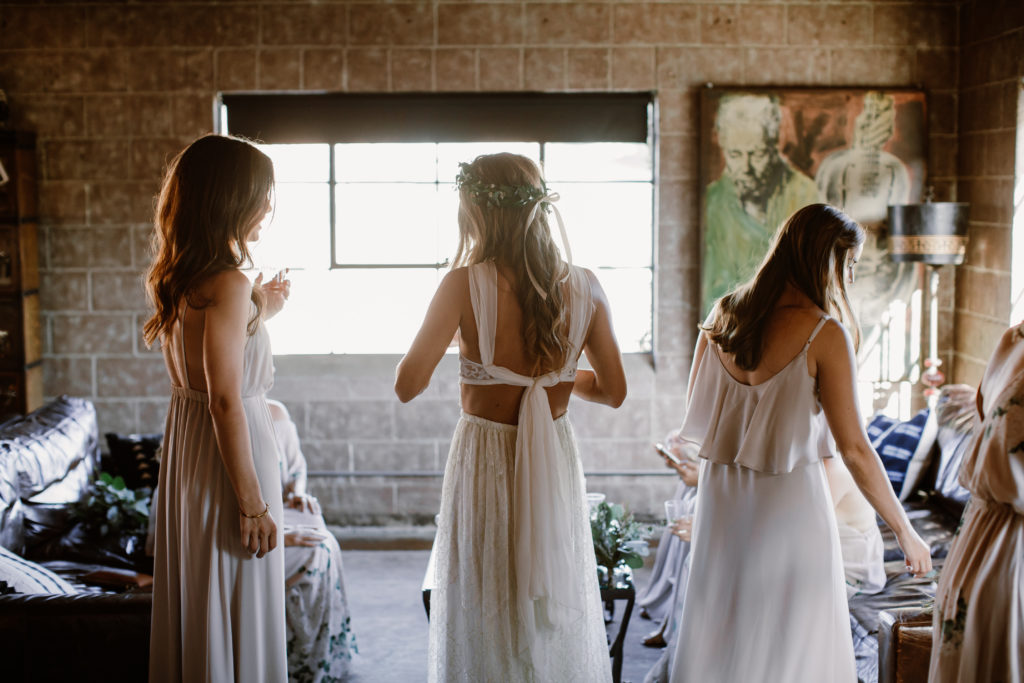 Bohemian bride getting ready for wedding at Smoky Hollow Studios