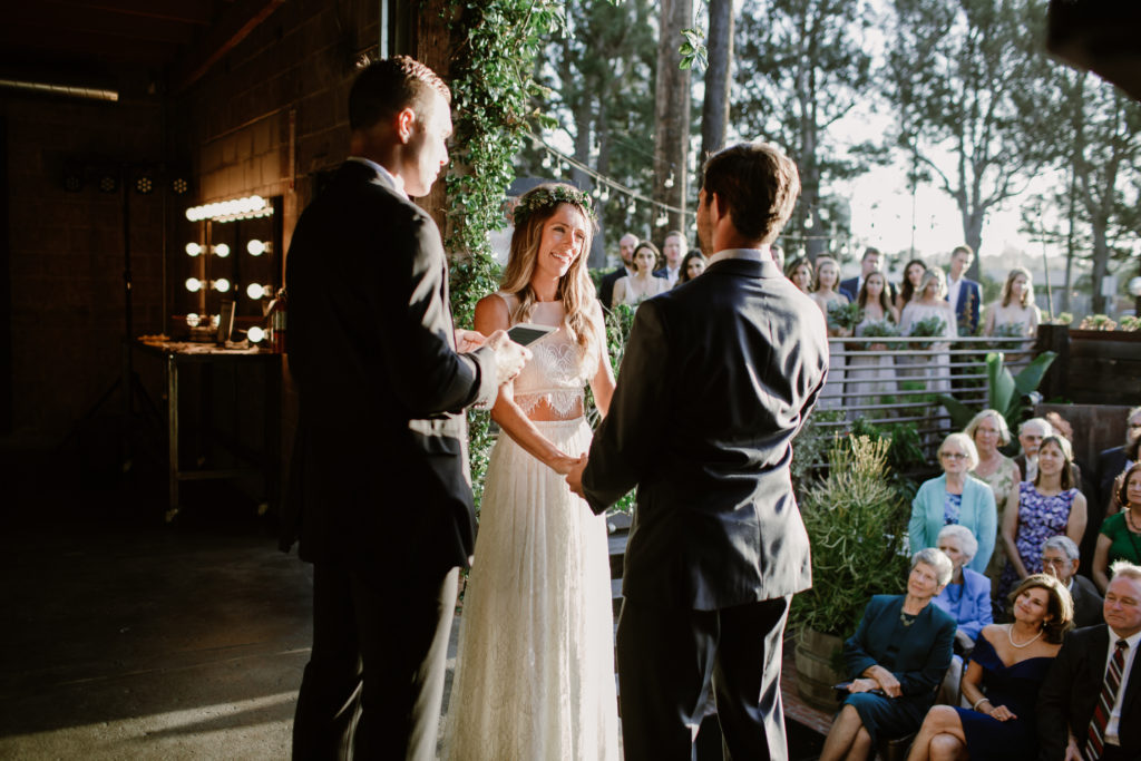 Bride and groom saying vows at Smoky Hollow Studios