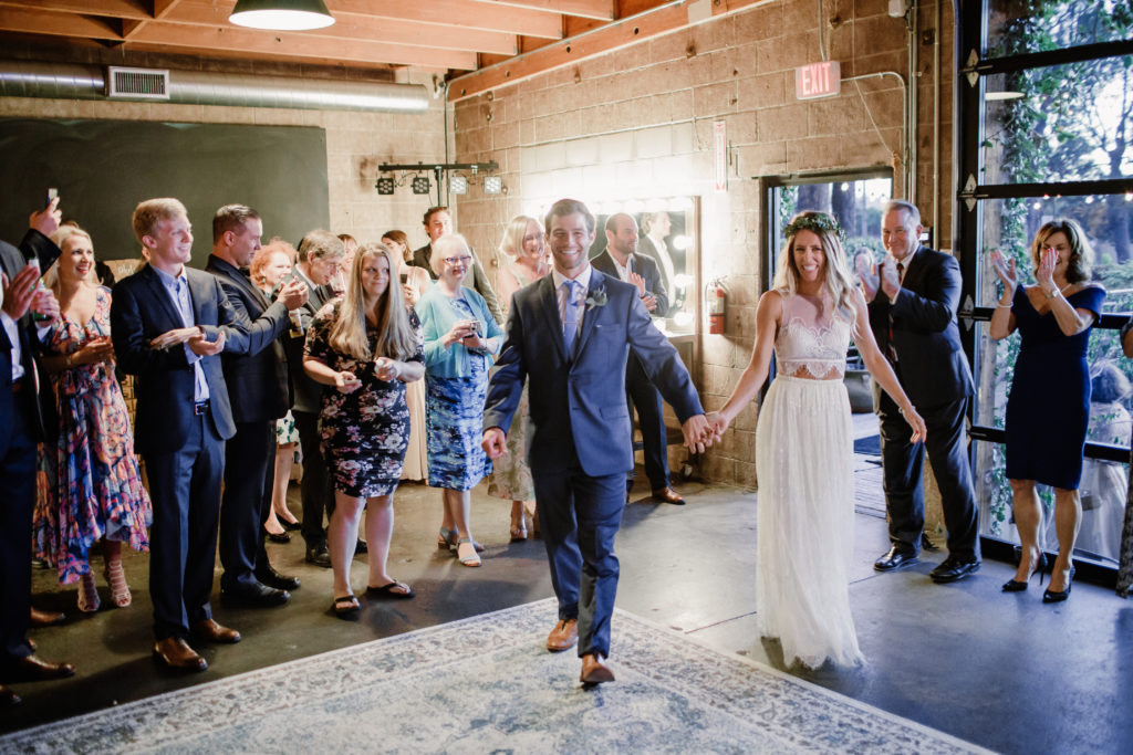 Bride and groom grand entrance at Smoky Hollow Studios