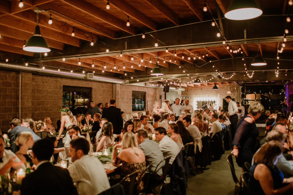 Rustic wedding reception under twinkling lights at Smoky Hollow Studios