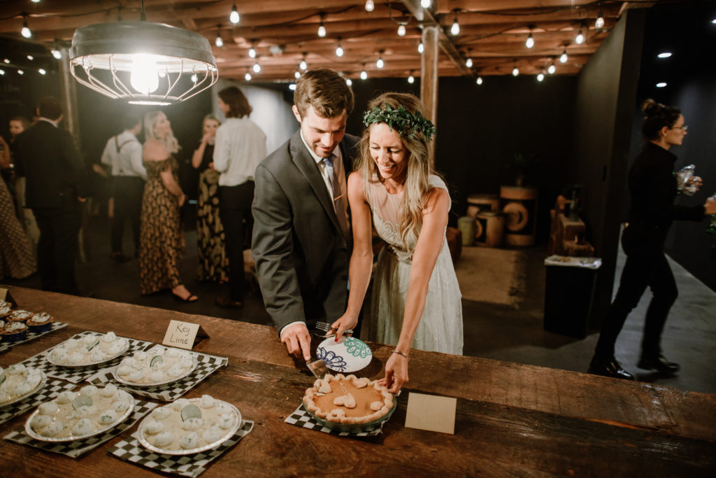 Bride and groom cutting cake at Smoky Hollow Studios wedding