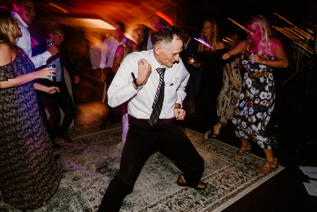 Man dancing and celebrating at wedding reception