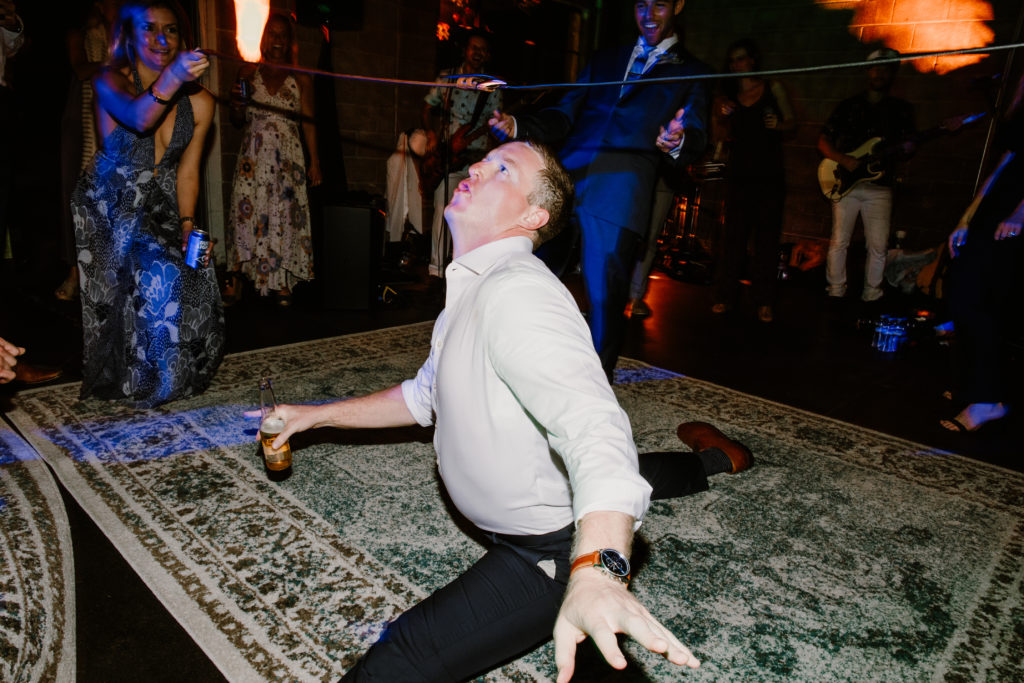 Man doing splits at wedding reception