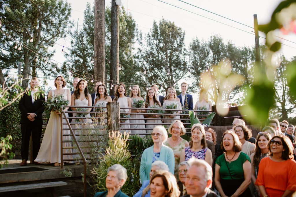 bridal party on patio of outdoor wedding ceremony at Smoky Hollow Studios
