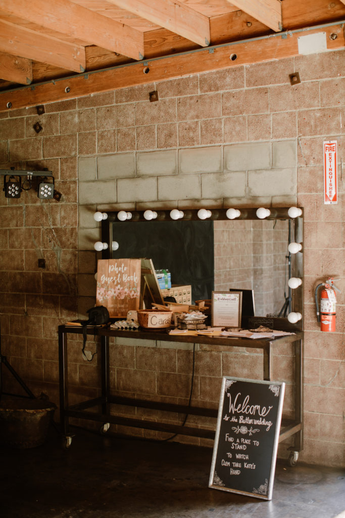 Rustic themed sign-in table for bohemian wedding