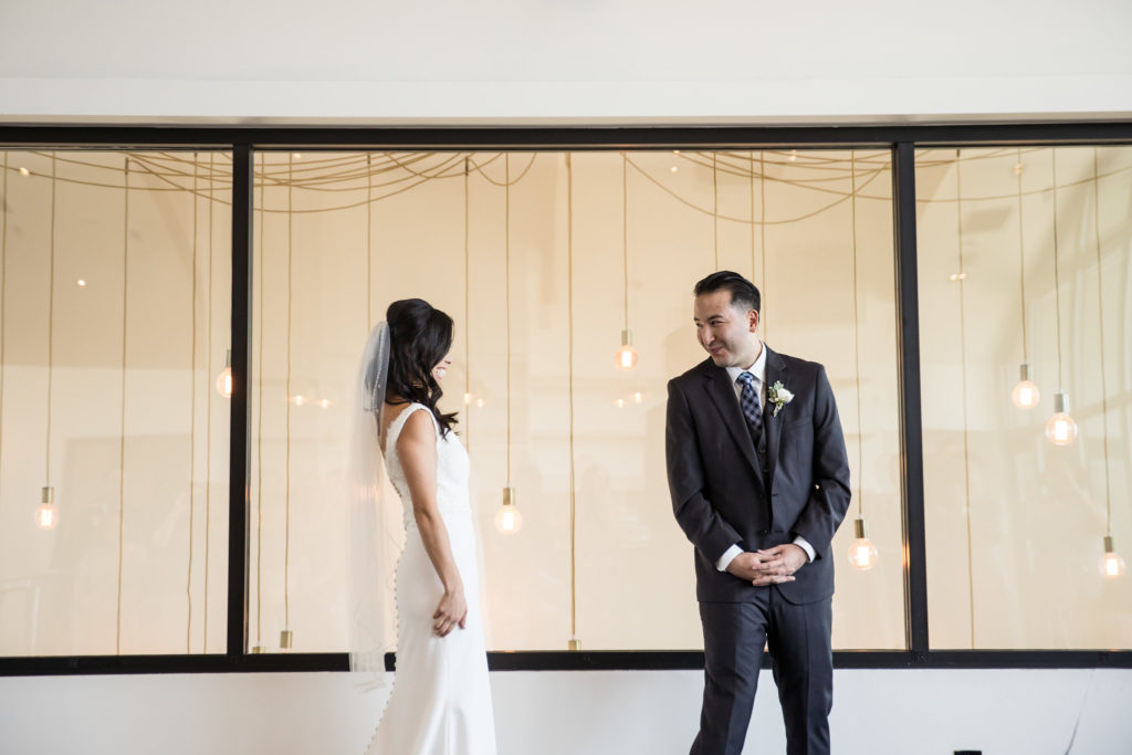 Bride and groom's First Look for modern wedding at The Colony House.