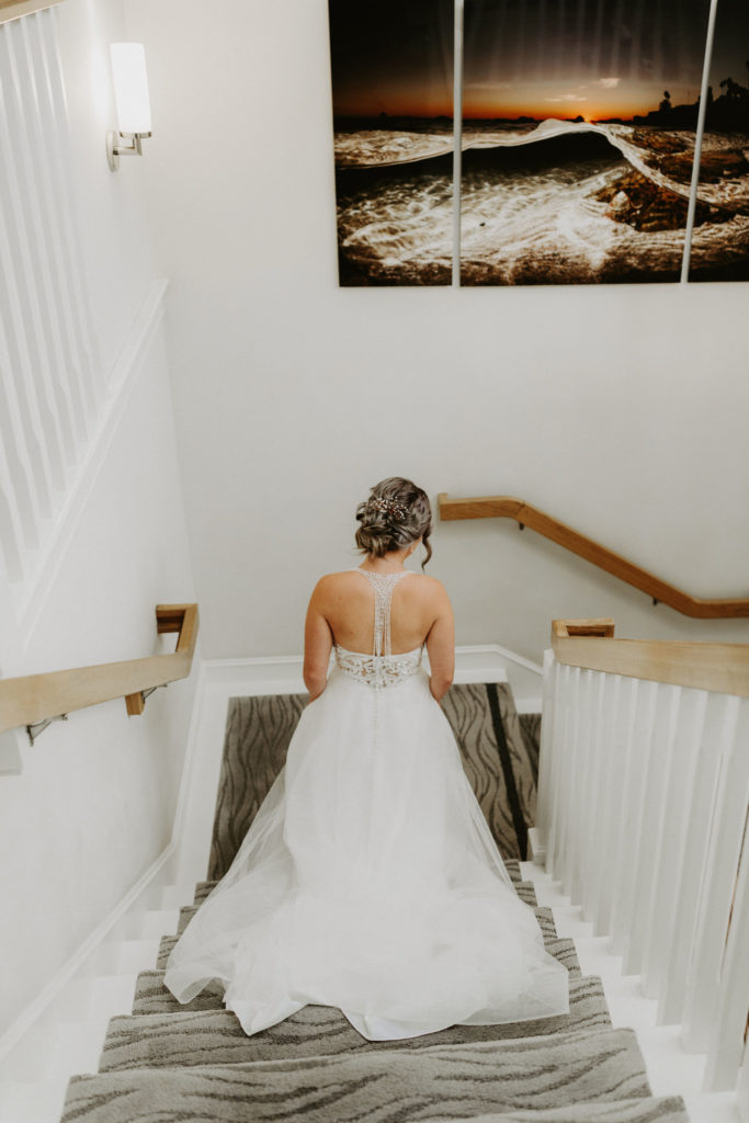 Bride walking down the stairs before the First Look at Pacific Edge Hotel in Laguna Beach