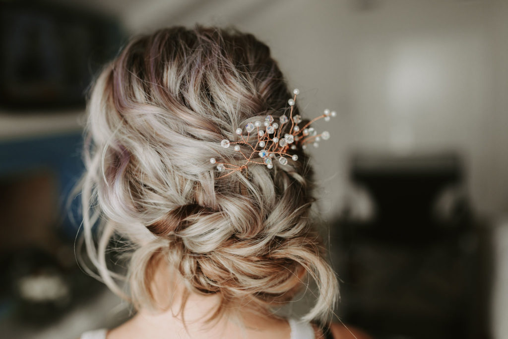 Blond updo with loose braid and hair jewelry for Laguna Beach Elopement