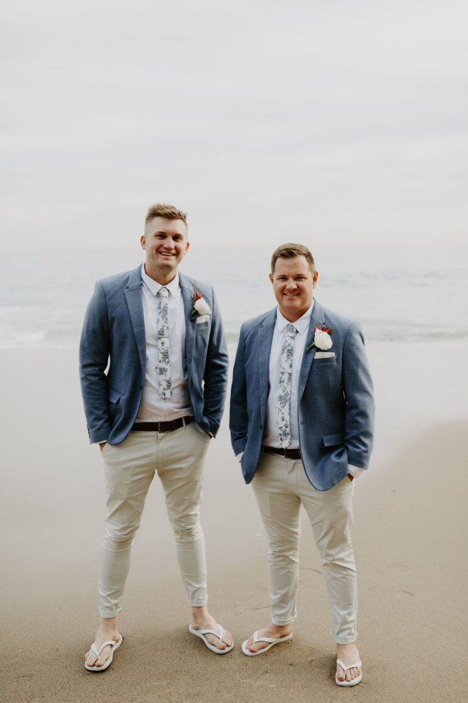 Groom and best man in light blue jackets and kaki pants before the ceremony in laguna beach
