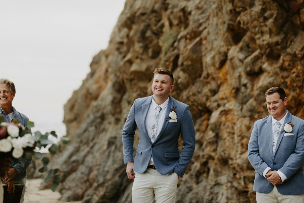 Groom sees his bride for the first time on the beach