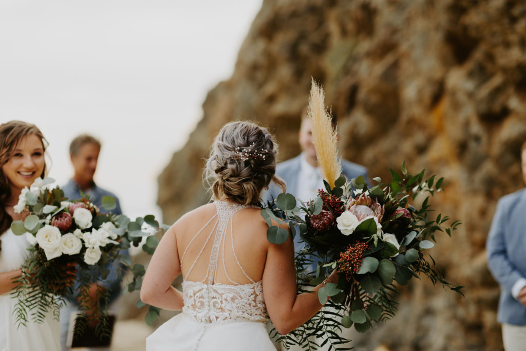 Bride walks down the beach and sees her groom for the first time in Laguna Beach