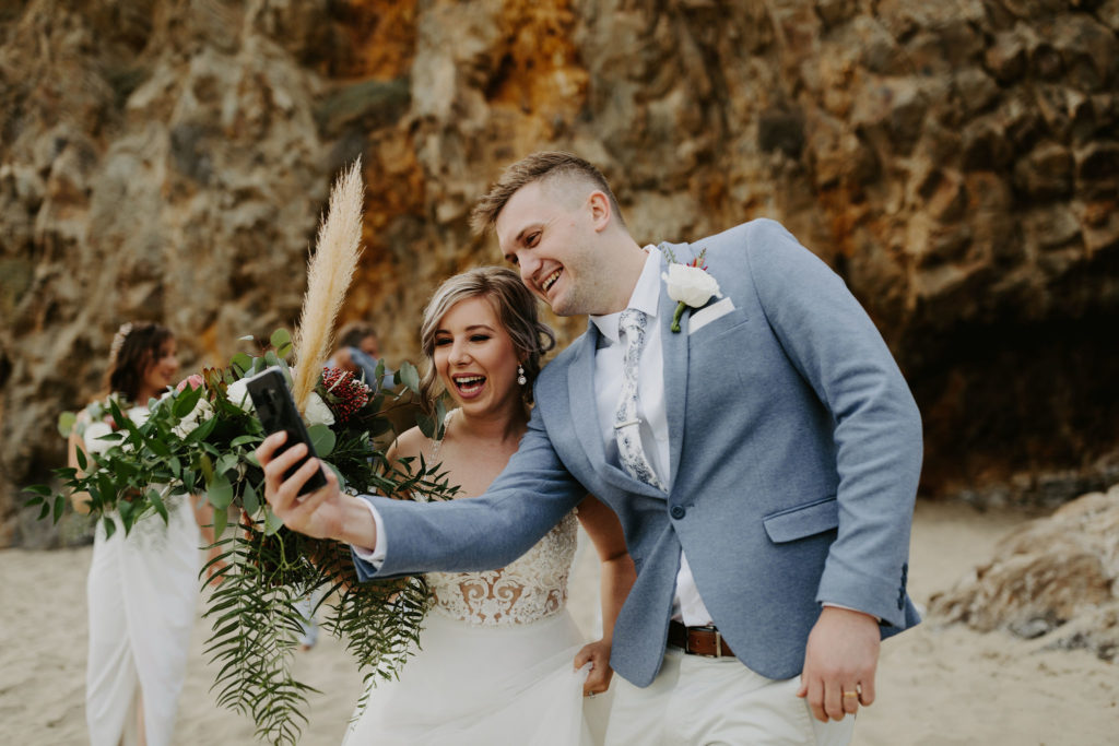 Bride and groom celebrate their elopement bu skyping with their families in Australia