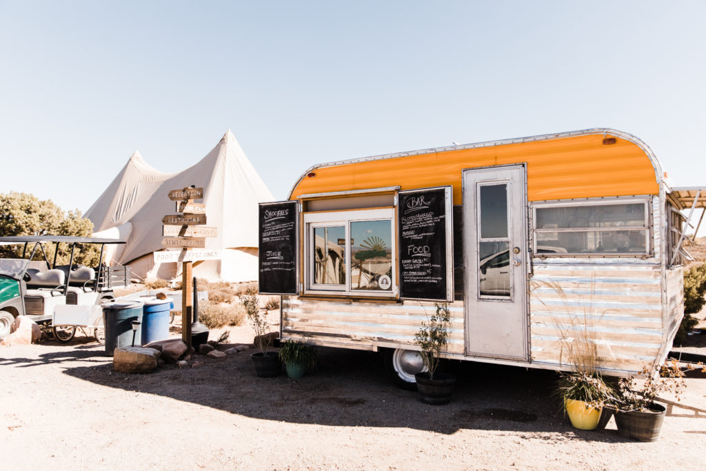 Airstream trailer bar used to serve drinks at a glamping wedding in the desert at Under Canvas Moab. Moab desert wedding for adventurous couple!