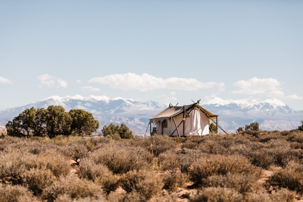 Glamping tent at Under Canvas Moab. Great outdoor venue for boho weddings and adventurous couples