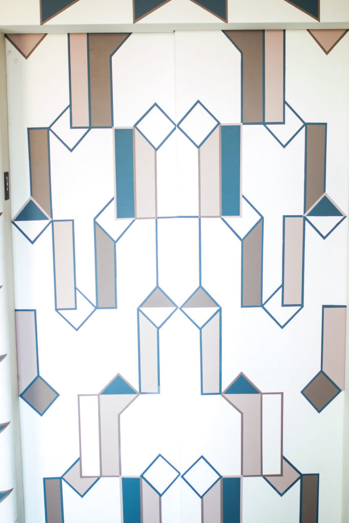 Blue, white and tan stained glass window. Boutique Hotel in Downtown Los Angeles, Hotel Figueroa is the perfect wedding venue for the modern bride or corporate event space for trendy companies