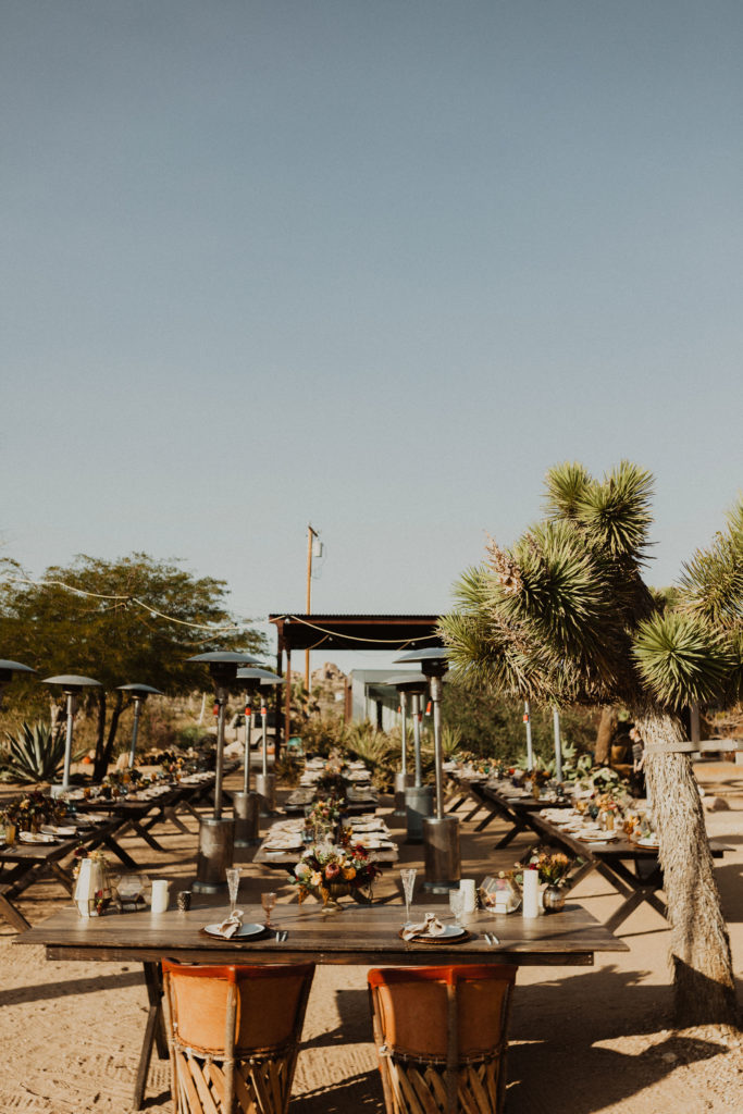 Long tables with red leather chairs at Rimrock Ranch in Joshua Tree, CA