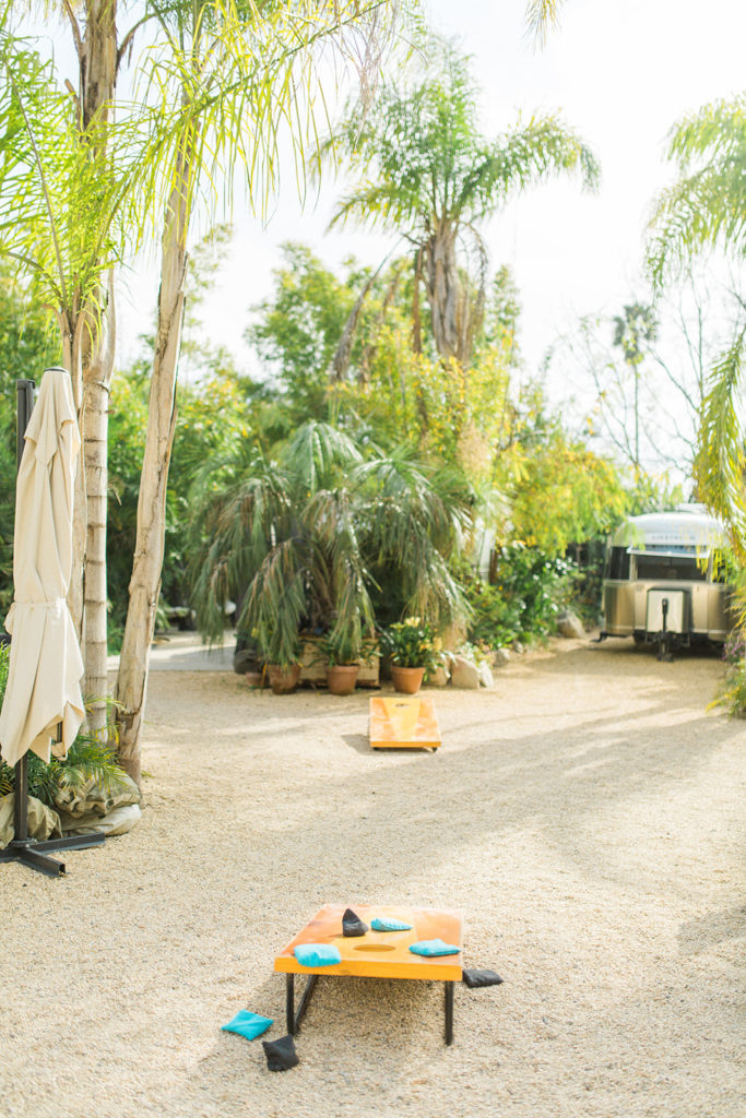 Wedding guests can play corn hole outside during cocktail hour at Caravan Outpost in Ojai