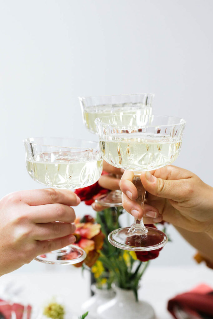 Cheers with crystal champagne coupes