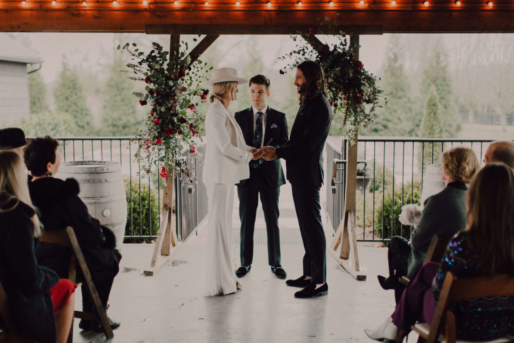 Intimate ceremony in Nashville at Arrington Vineyards | Rainy ceremony under covered patio with bistro lights | Cause We Can Events | Adventurous Destination Weddings