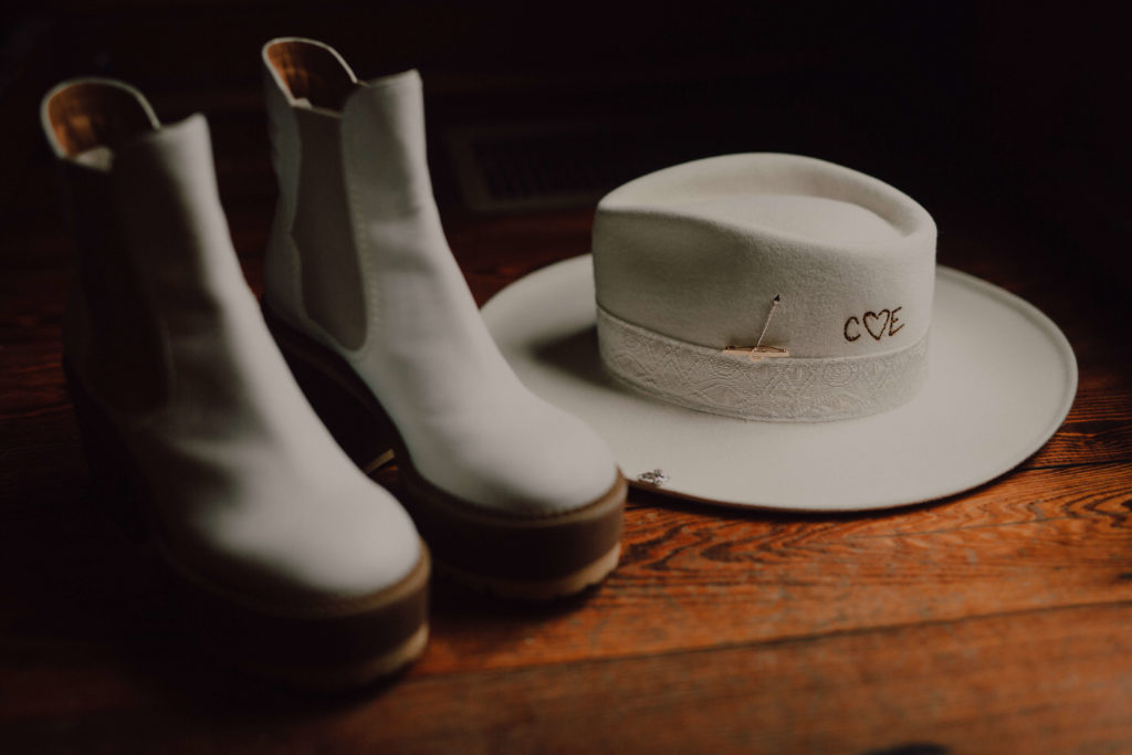White hat and platform boots for bride getting married at Arrington Vineyards in Nashville, TN | Cause We Can Events