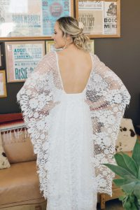 Grace loves lace dress with lace wings over the arms. Wedding in the desert at Rimrock Ranch, Joshua Tree.