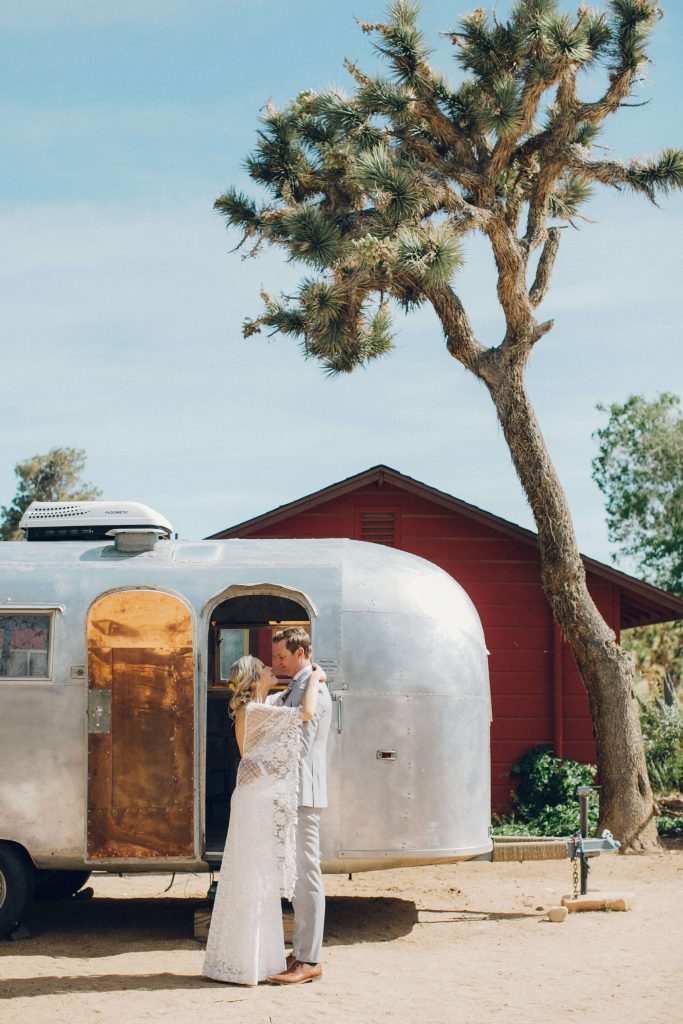 First look in the desert with bride and groom in front of an airstream trailer at Rimrock Ranch