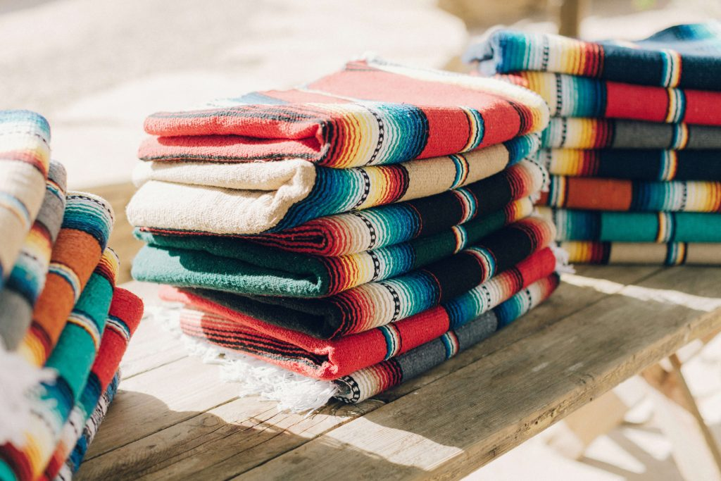 Pile of mexican blankets as wedding favor for desert wedding
