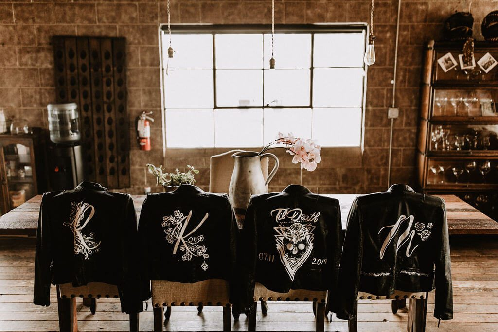 Painted leather jackets for bride and bridesmaids at wedding at Smoky Hollow Studios