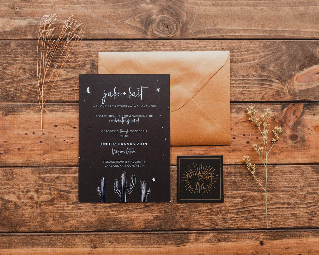 Black and gold wedding invitations with stars, moons and cacti