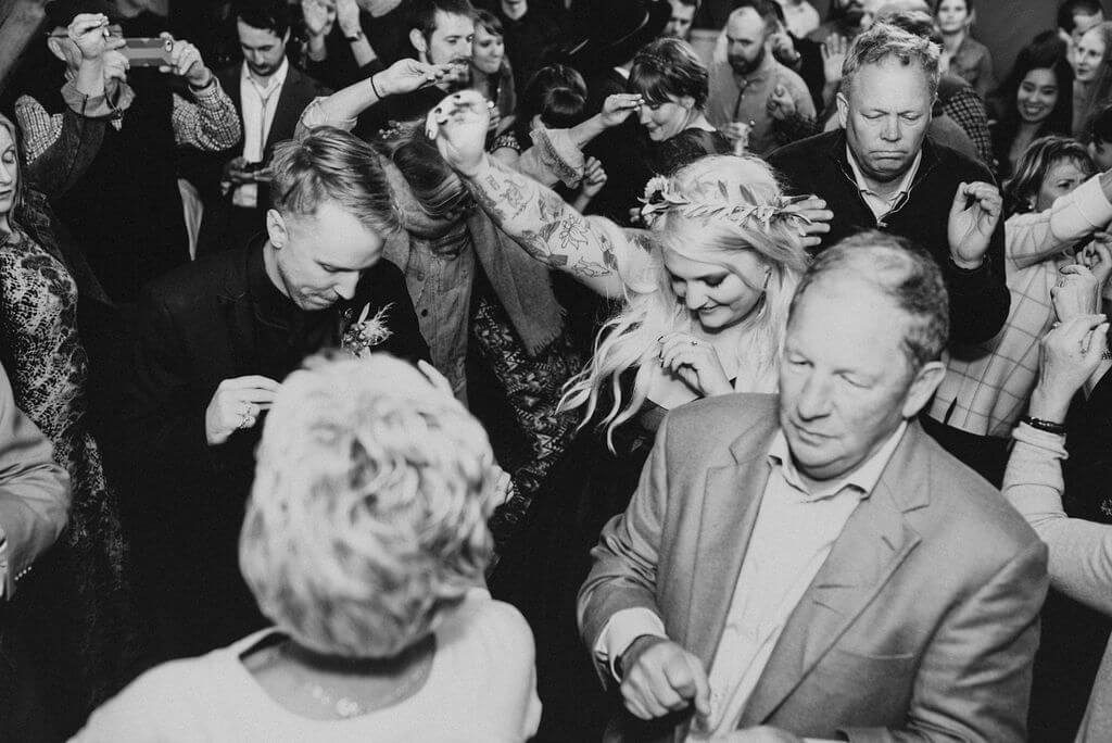 black and white photos of guests dancing at wedding at Under Canvas ZIon