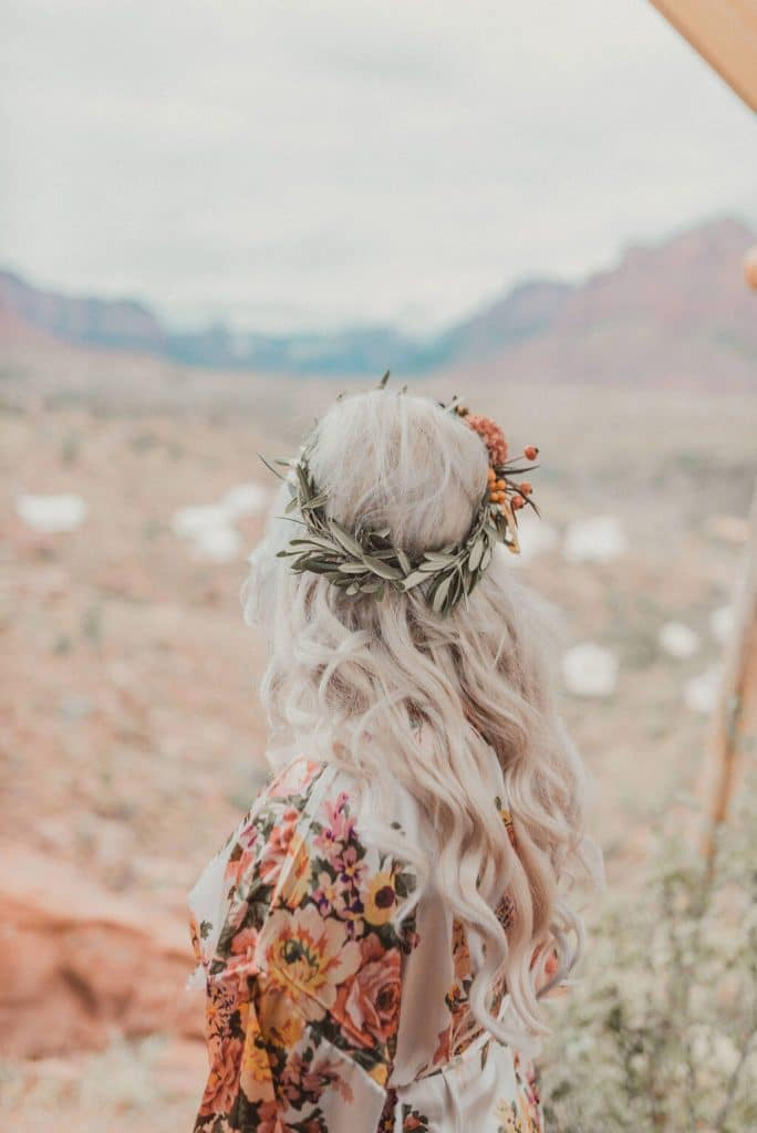 Blonde bride with flower crown at glamping wedding in Zion